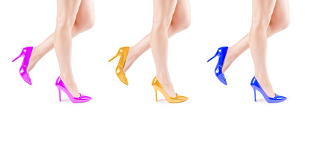 Female legs in colorful shoes photo