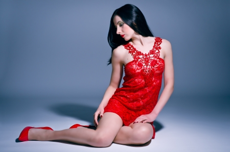 Sexy young woman in red lace nightie photo
