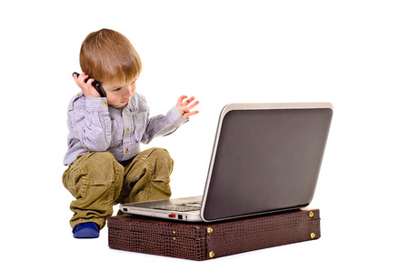 gesticulating: Beautiful boy gesticulating hands speaks on the phone looking at laptop Stock Photo