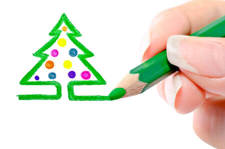 Photo picturing hands pencil a Christmas tree photo