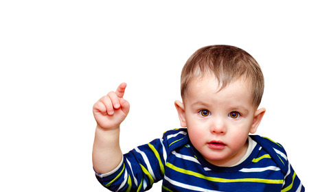 Portrait of beautiful boy pointing finger at camera