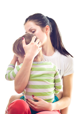 Mother calms a crying child  White  photo