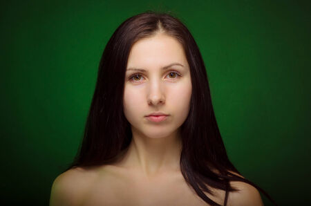 Portrait of a beautiful young brunette  The concept of natural beauty