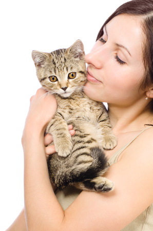scottish straight: Beautiful  woman with a kitten in her arms Scottish Straight Stock Photo