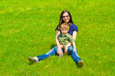 Mother and son outdoors photo