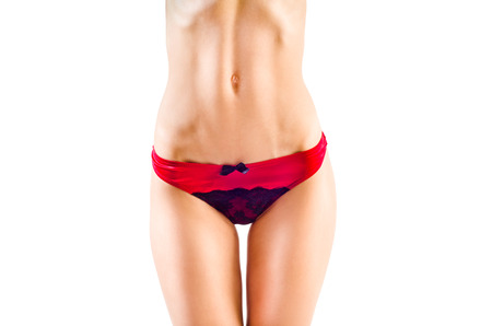 Sexual slim female figure in red panties photo
