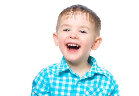 Portrait of a beautiful laughing boy isolated on white background
