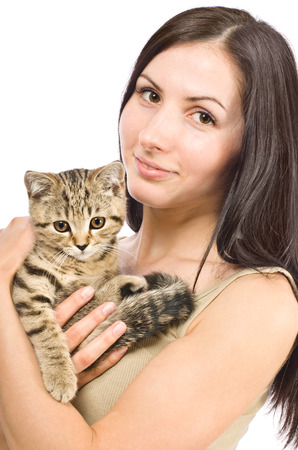 scottish straight: Portrait of a beautiful young woman with a kitten Scottish Straight in her arms  Stock Photo