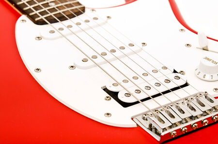 Photo the electric guitar red color closeup photo