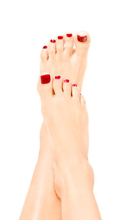 the well groomed: Beautiful well-groomed female feet with red pedicure Stock Photo