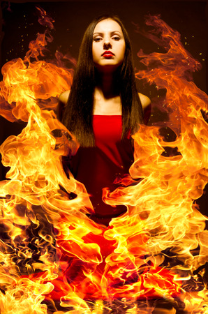 Portrait of a beautiful young woman on fire photo