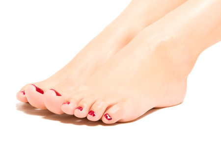 Beautiful female foot with red pedicure isolated on white background 스톡 콘텐츠