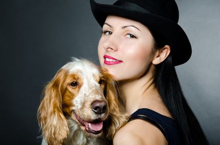 cap hunting dog: Portrait of a beautiful young woman and Russian Spaniel Stock Photo