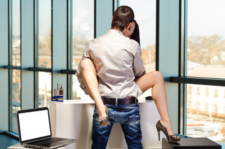 female sex: Young business couple are having sex in the workplace
