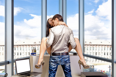 adult sex: Young business couple are having sex in the workplace