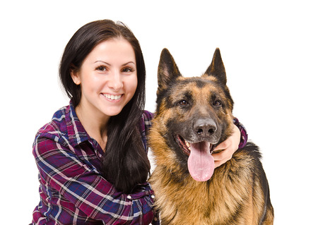 caucasian shepherd: Portrait of a smiling beautiful young woman and German Shepherd closeup isolated on white background