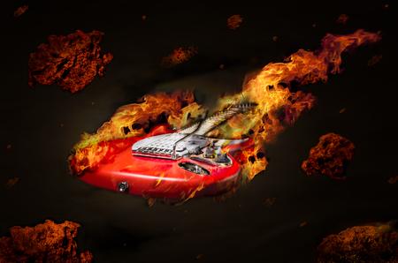 meteorites: Burning guitar flying in space among meteorites