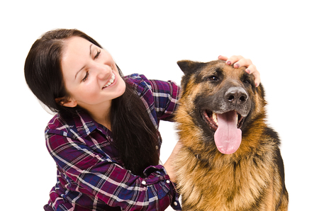 friend hug: Portrait of beautiful young woman and a German Shepherd isolated on a white background