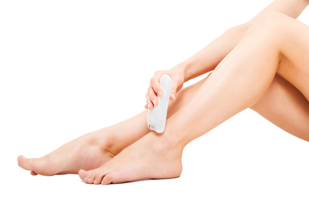 barefoot women: Beautiful well-groomed female legs with the epilator isolated on white background Stock Photo