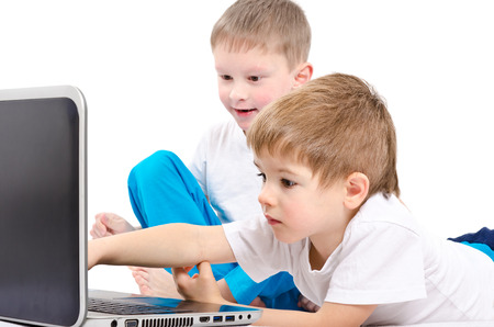 laptop screen: Two children looking on laptop screen isolated on white background Stock Photo