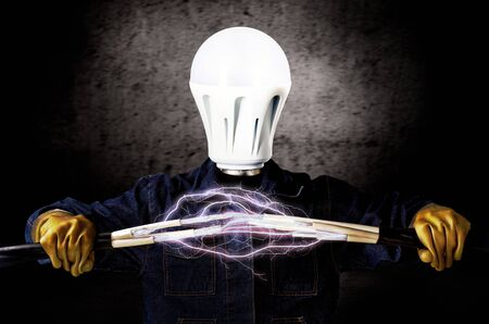 voltage gray: Electrician with a light bulb instead of a head keeps cables that shoot lightning Stock Photo