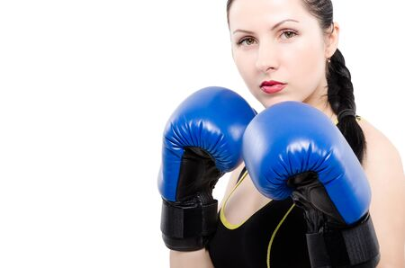 pugilist: Portrait of a beautiful young woman in boxing gloves isolated on white background