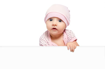 Portrait of cute curious baby girl, peeking from behind a banner, isolated on white background