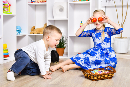 Cheerful brother and sister playing in the Easter holiday.jpg Stock Photo