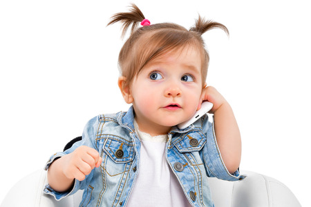 Portrait of a beautiful little girl, talking on the phone, isolated on white background Stock Photo