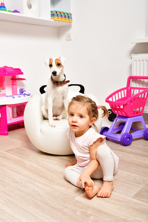 Little cute girl in the playroom