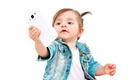 Portrait of cute little girl taking selfie on mobile phone Banco de Imagens - 119754622