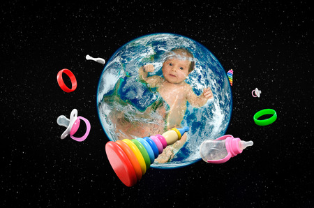 Baby in planet Earth accessories. Stock Photo