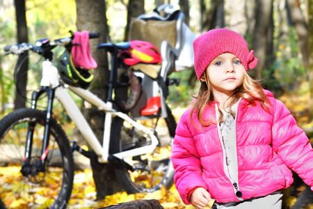 Portrait of a cute girl in the autumn forest