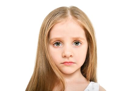 Portrait of a beautiful sad little girl, closeup, isolated on white background Stock Photo