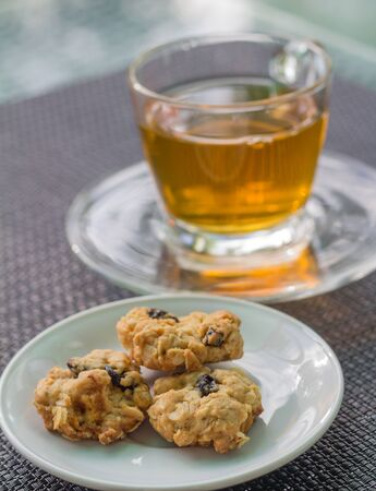 ingestion: Breakfast with tea and fresh oatmeal cookies Stock Photo