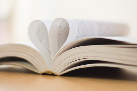 Opened a book with heart shaped page Stock Photo