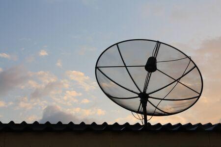 sattelite: Stock Photo - Sattelite dish on twilight sky