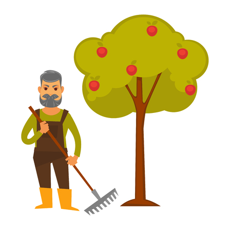 Elderly man with rake stands beside apple tree