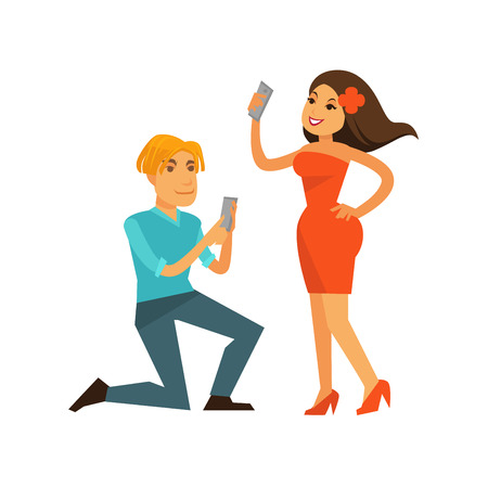 smartphone: Young man and woman taking photos of themselves