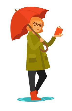Woman in coat and rubber boots stands under umbrella