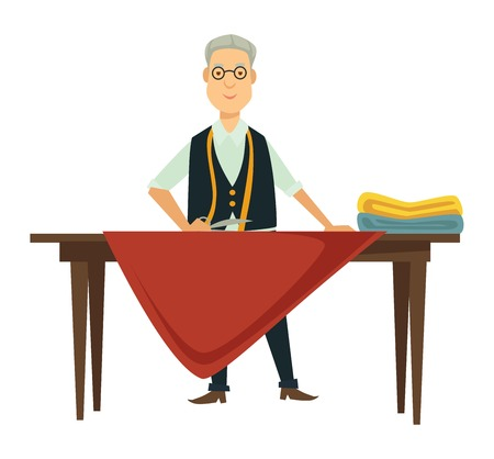 Male designer works on new outfit at table