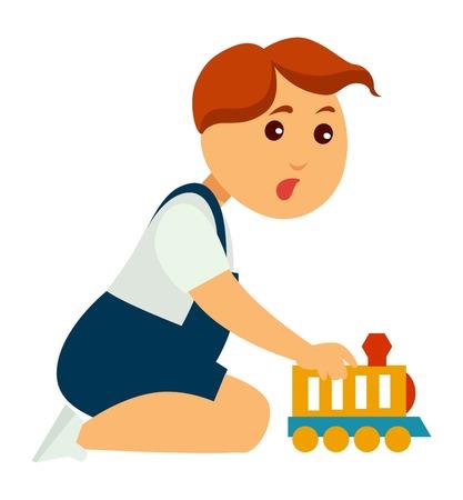 Petit garçon qui a le visage excité joue avec un train jouet