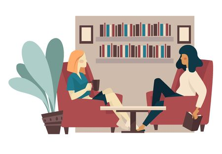 Girlfriends drink tea and talking in home library