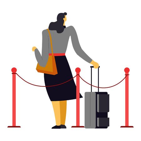 Woman with suitcase and purse behind fence proceeding to plane