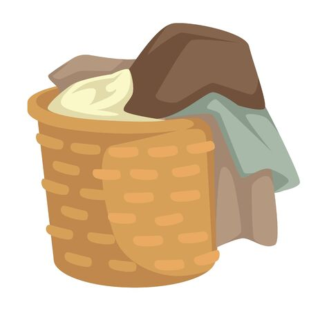 Clothes and linen laundry in wicker basket isolated object