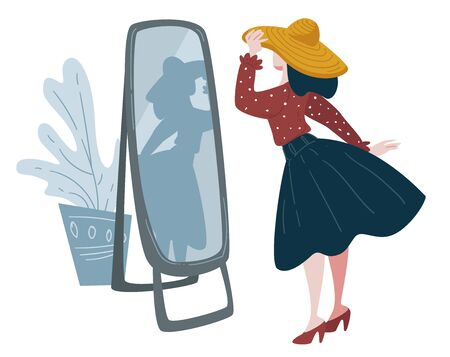 Woman trying on hat in front of mirror, fashion shopping