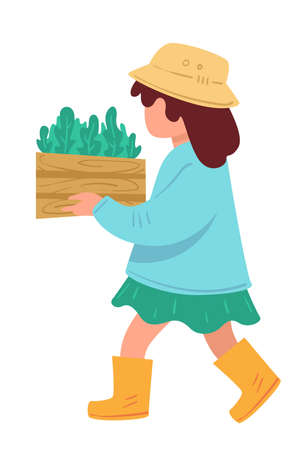 Kid carrying basket with growing plants or herbs