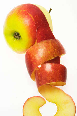 Red apple with twisted peel rings.  Stock Photo