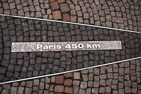 Sign on the ground with number of kilometers to Paris. Photo made in Baden-Baden, Germany Stock Photo