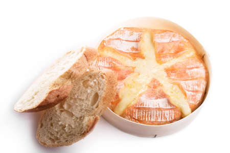 Backed camembert cheese with french baguette. Object isolated on white background.